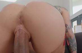 Tattooed pornstar wearing stockings fucks black dude on the couch