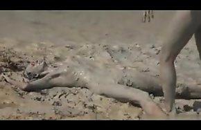 Girls wrestling in a difficulty mud
