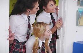 Three kinky teen schoolgirls make out